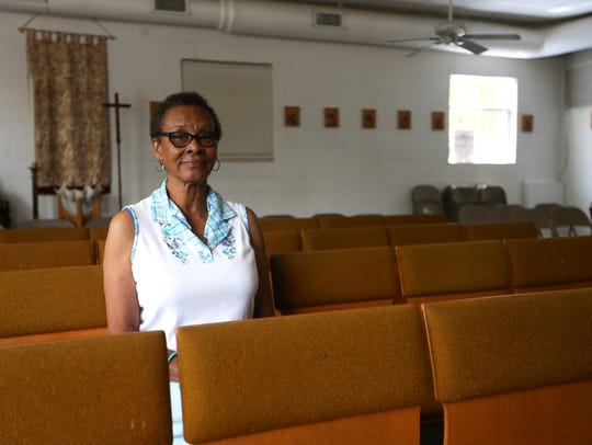 Rhonda Donaldson sits in the Grace Mission chapel,