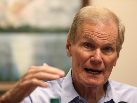 U.S. Senator Bill Nelson speaks with college graduates