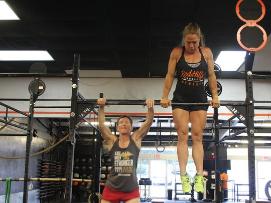 """""""Staying up here is easy,"""" says Fahey. """"The hard part is getting up."""" Nevertheless, the two make everything from pull-ups to ring balances look easy."""