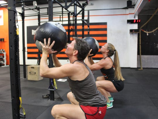 For the past several months, both women have been training intensively in preparation. Part of their workouts includes bouncing medicine balls off a high target, targeting quad, arm and glute strength.