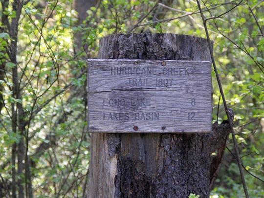 Signs at the Hurricane Creek Trailhead.
