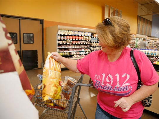 Dena Siemer, 45, a housewife from Dayton, Ky, plucks