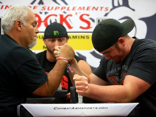 Rodo Rodriguez (left) competes with Jeremy Reyes in an arm wrestling competition during the Corpus Christi BikeFest on Saturday, Oct. 11, 2015, in Corpus Christi.