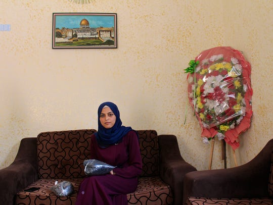 Ahlam Abo Thaher, 25, seated in her home in Deir al-Balah,