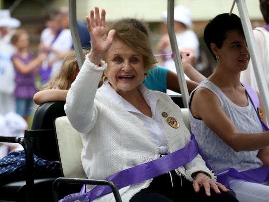 U.S. Rep. Louise Slaughter, D-Fairport, waves from the Suffragist City Parade Saturday, July 22, 2017, in Rochester. The parade was among several events in VoteTilla, a weeklong celebration marking the 100th anniversary of women's right to vote in New York State.