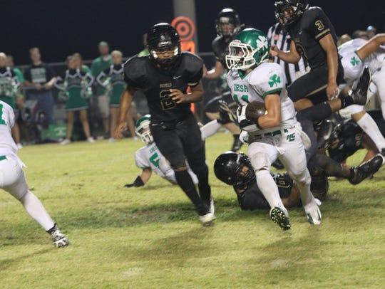 Nolas Seay runs around the left end for a touchdown