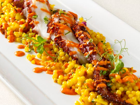 Grilled marinated octopus with chorizo couscous, toasted