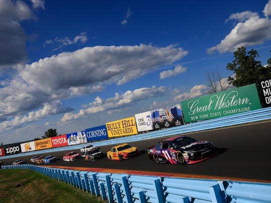 Denny Hamlin leads Joey Logano and others through the