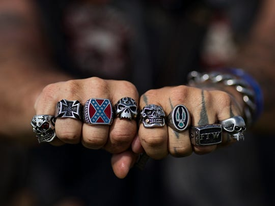 Reno, a biker that declined to share his last name, shows off his rings during the Sturgis Kentucky Bike Rally. Rebel flags, skulls and other representations of independence and counter culture are popular ornamentation among attendants. July 14, 2017