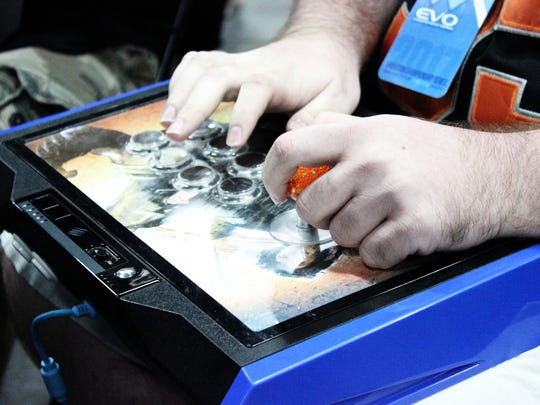 David Repicky mashes buttons on his custom-made joystick at a Las Vegas video game tournament this month.