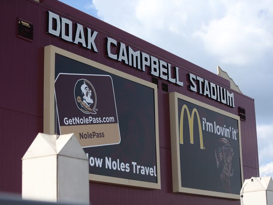 Corporate sponsorship logos have been added to new signage atop FSU's Doak Campbell Stadium.