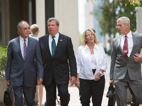Former Wilmington Trust President Robert Harra Jr. (second from left) arrives at the federal courthouse in Wilmington in 2015. Accompanying him are his wife, Linda, lawyer Michael Kelly (far right) and lawyer Andrew Lawler.