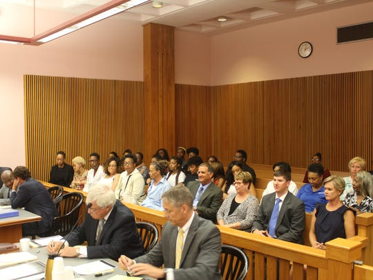 Most of the seats were filled in a third-floor courtroom