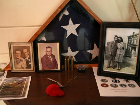 Photos of Barbara Myers' father Charles, who also served