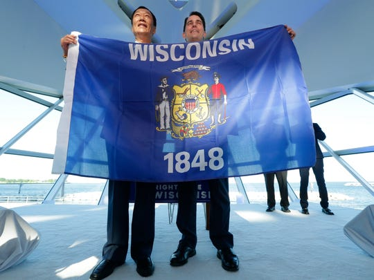 Gov. Scott Walker and other state officials joined Foxconn Technology Group leaders, including Foxconn Chairman Terry Gou, at the Milwaukee Art Museum in 2017 to celebrate FoxConn's $10 billion investment to build a display panel plant in Wisconsin that could employ up to 13,000 workers and draw up to $3 billion in subsidies from state taxpayers.
