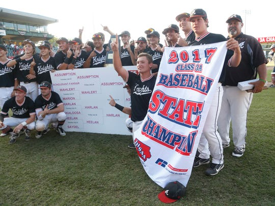 Davenport Assumption celebrates their win over Harlan Saturday, July 29, 2017, Friday, July 28, 2017, in the 3A state baseball championship at Principal Park in Des Moines.