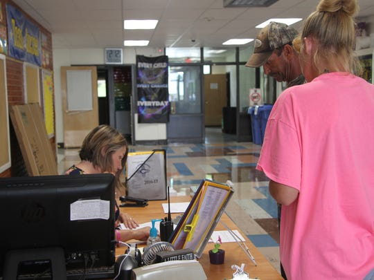 Jesse Phillips and Kimberly Harrel complete student enrollment for their daughter, who will be in the fourth grade at Monterrey. Enrollment for elementary students was Monday, July 31, 2017.