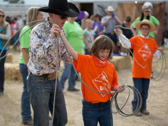 Rodeo cowboys teach participants the basics of roping at the 2016 Exceptional Rodeo.