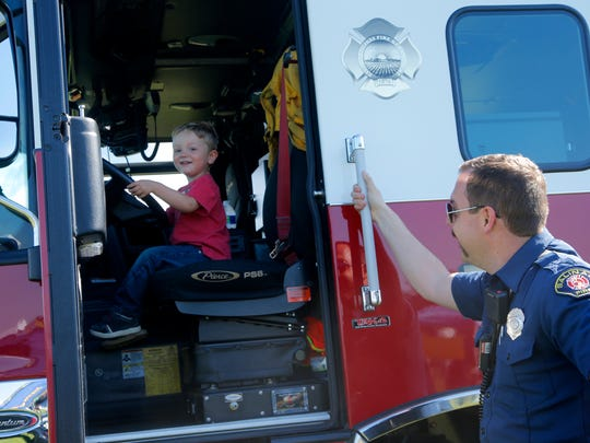 Connor McClain, 2, sits in the driver's seat of a Salinas Fire engine at the National Night Out celebration in Salinas on Tuesday.