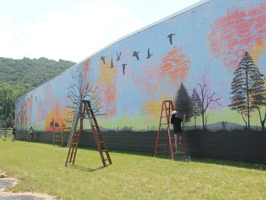 Chenango Valley High School art students work on a