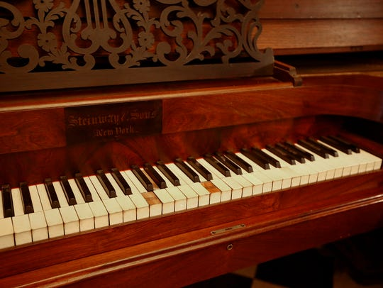 An old Steinway and Sons folded grand piano dating