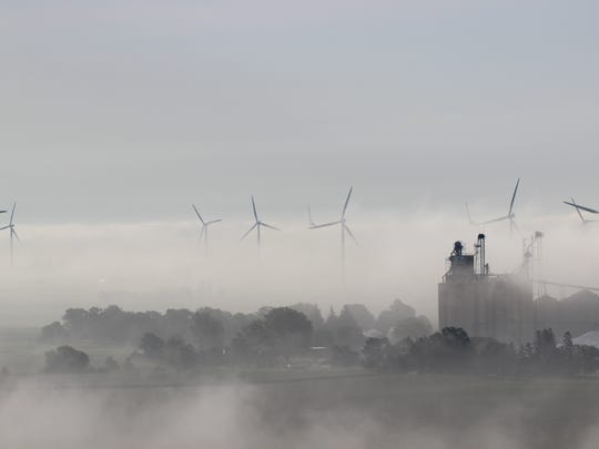 Alliant Energy's wind farm in Franklin County. Under a proposed settlement, groups opposed to a rate hike for the utility are calling for it to use more alternative energy sources instead of coal.
