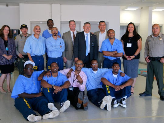 Inmates and staff at Salinas Valley State Prison pose