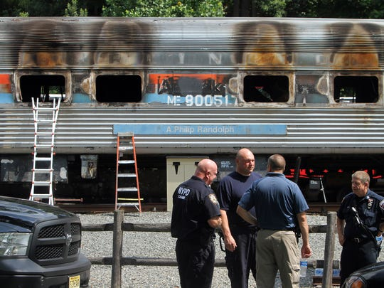 Investigators at the Whippany Railway Museum in Whippany where two historic railroad cars were taken after they were destroyed overnight in a fire in East Hanover. August 4, 2017. Whippany, NJ