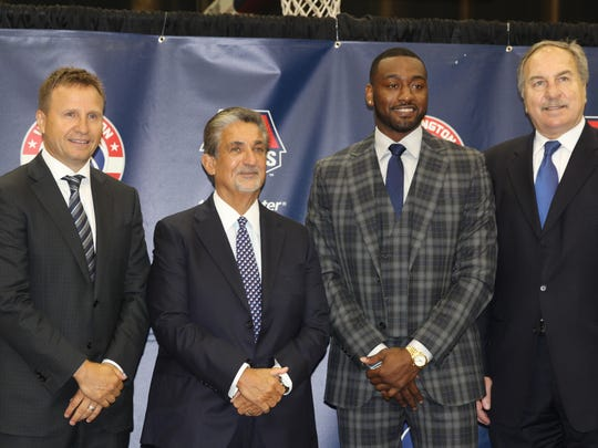 Wizards guard John Wall with coach Scott Brooks, owner