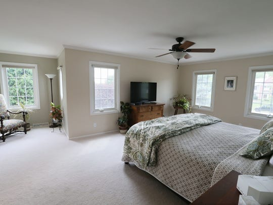The master bedroom is home to several of the couple's