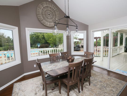The dining area in the kitchen looks out onto the backyard.