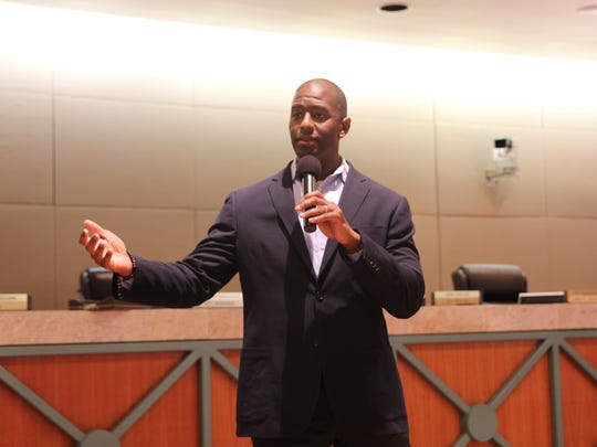 Mayor Andrew Gillum addresses a crowd at a Tallahassee crime town hall on Aug. 8