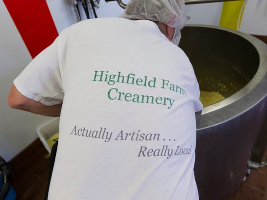 Terry Woods stirs cheese curd Aug. 7 at Highland Farm