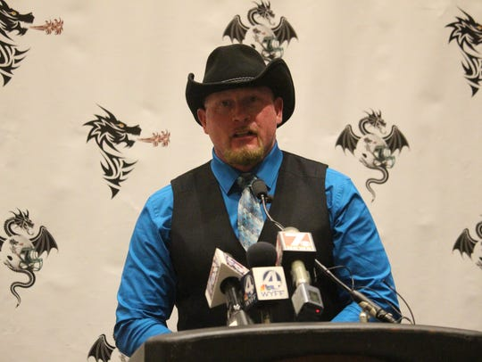 Upstate Dragons head coach talks at a news conference