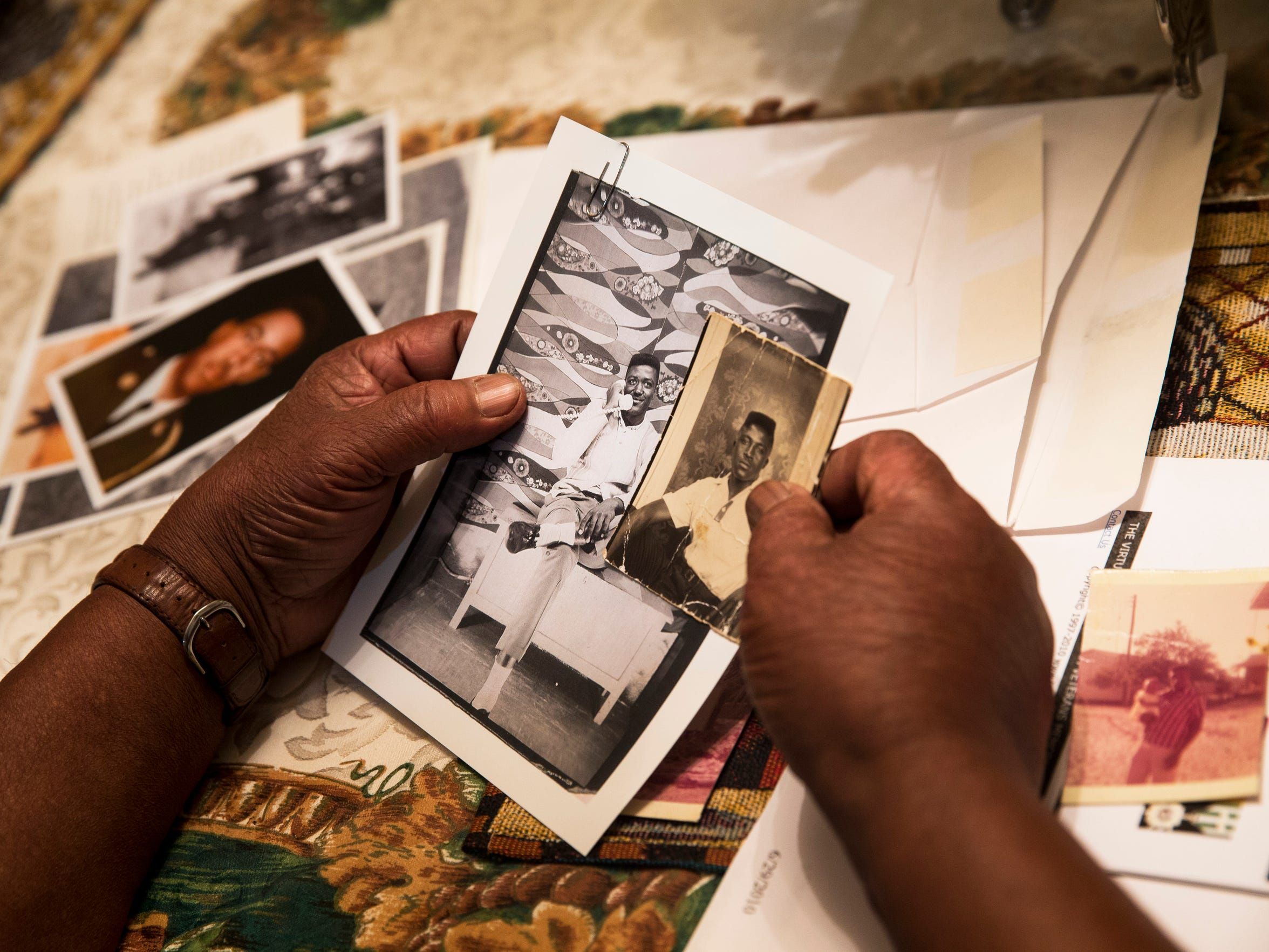 Orsie Anthony, one of two surviving Anthony brothers, compares a photo of himself, right, to a photo of his brother Charlie at his home in Naples on Tuesday, June 13, 2017. Orsie recalls family members always commenting on their close resemblance.