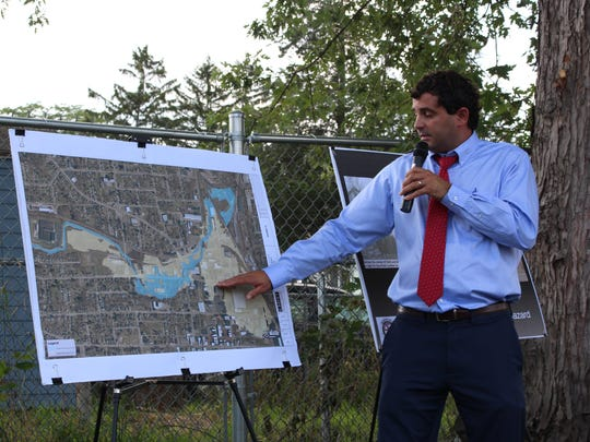 City engineer Bob Bianchi explains a proposed $14-million project to stop flooding in the city during a meeting Wednesday, Aug. 9, 2017. About 20 residents came out to listen to Bianchi's presentation at the Citizen Action Sector Meeting at the Blust Avenue Teaching Garden.