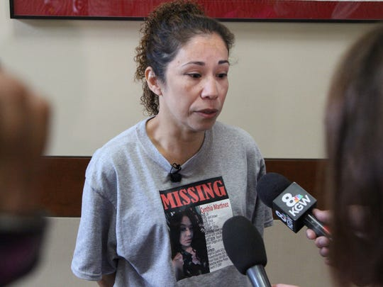 Angelica Castillo, the mother of missing Woodburn woman Cynthia Martinez, speaks with the media at Keizer Police Department on Wednesday, August 9, 2017.