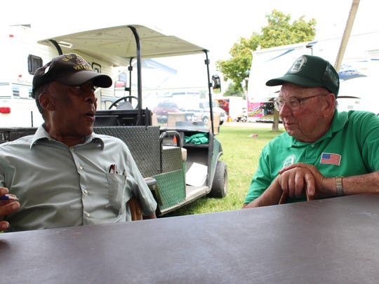 Korean War Army veteran Johnny Givand, left, shares war stories with Korean War Army veteran David Barnhart in the veterans' tent at the Richland County Fair on Thursday, Aug. 10, 2017. Barnhart is a past Richland County fair board member.