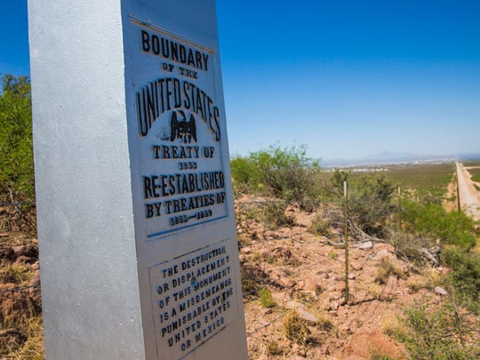 A marker indicates the border with Mexico in the desert