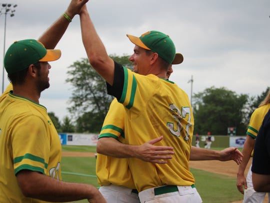 Members of the Renner amateur baseball team celebrate