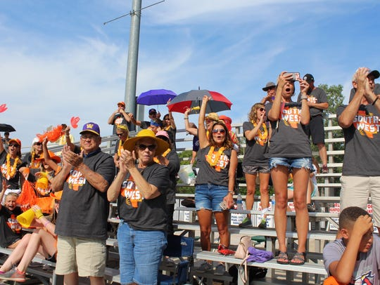 Wylie fans cheer during the team's 12-8 win over the