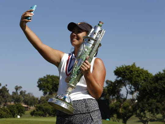 Sophia Schubert takes a selfie as she holds the Robert Cox Trophy after winning the final round of match play at the 2017 U.S. Women's Amateur at San Diego Country Club in Chula Vista, Calif. on Sunday, Aug. 13, 2017.