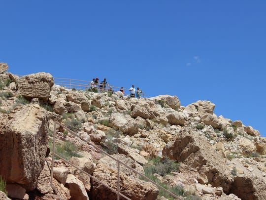 Stairs from the visitor center lead to the highest vantage point at Meteor Crater. The lower level is wheelchair-accessible.