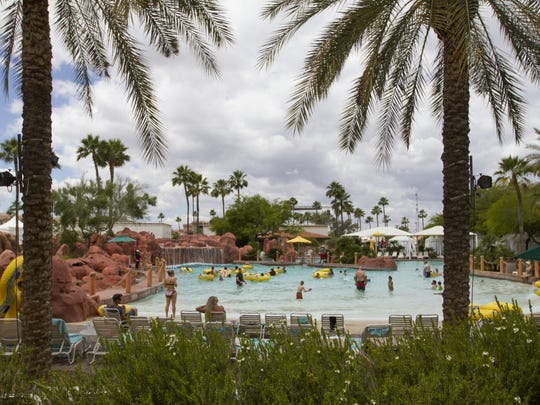 People enjoy the wave pool at the Oasis Water Park at the Arizona Grand Resort, Sunday, April 27, 2015, in Phoenix.