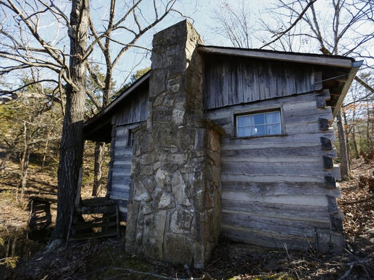 An old hunting cabin sits next to a pond at the 1,011-acre Ozark Mountain State Park.