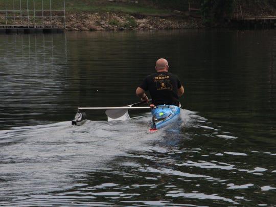 Brad Daniels uses a lightweight carbon fiber paddle