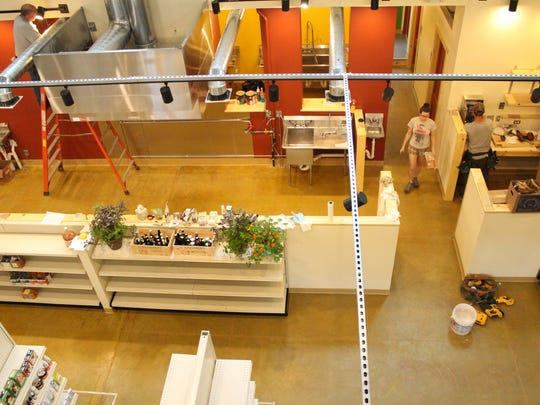 A view from the new loft within the Downtown Grocery building shows views into a new kitchen and a more open floor plan.