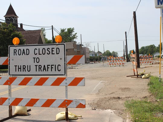 A road closed sign stops travelers before reaching the road construction on Thomas Street in Wausau.