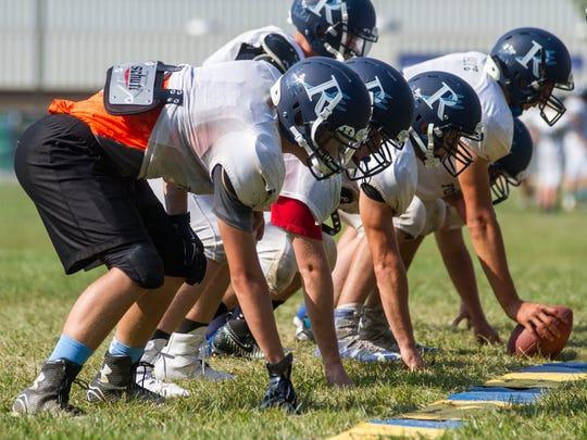 Players for the Richmond High School Blue Devils form a line of scrimmage before a practice play on Aug. 16. The Blue Devils will play their first game against Marysville on Aug. 24.