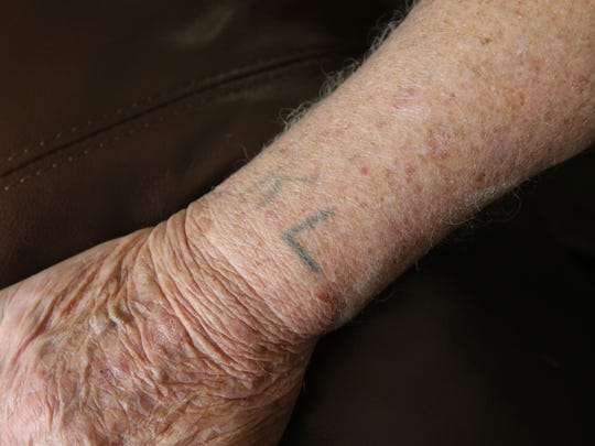 "Nate Taffel of Mequon, a Holocaust survivor, shows the ""KL"" that is tattooed on his wrist. It is the German abbreviation for konzentrationslager (concentration camp)."